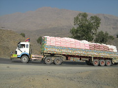 Trucks for Afghanistan (imranthetrekker , Bien venu au Pakistan) Tags: city friends pakistan food sun tourism architecture clothing colorful tourists backpacking peshawar nwfp afghnistan khyberpass pakistanicuisine imranthetrekker imranschah torkhamborder ladiesclothes landikotal tribalareas chitralguy kebabseekhkebab brassmarket womeninpeshawar femaletravelers
