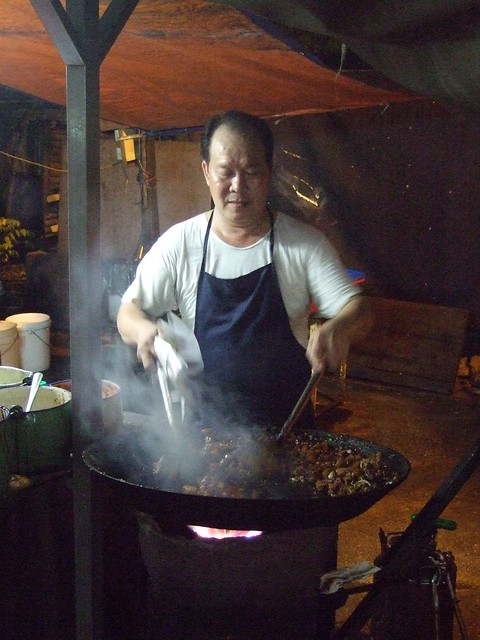Food hawker in Malaysia preparing a dish