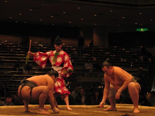 Sumo wrestlers staring