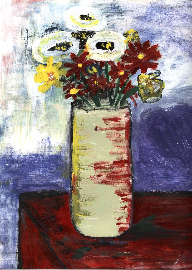 flowers in tall vase