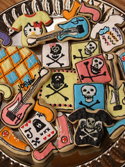 Punk Rock Cookies (nikkicookiebaker) Tags: music skulls guitars tshirts converseshoes decoratedcookies