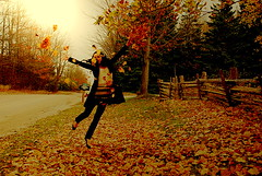 Mary Poppins (monsters.monsters) Tags: road autumn trees portrait orange woman brown selfportrait ontario canada nature girl grass leaves yellow female mailbox fun happy jumping nikon afternoon play ground save sideroad warmtones caledon d80