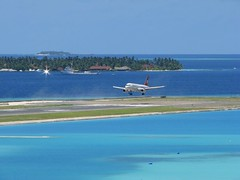 Landing Runway 18 ( DD) Tags: blue sea sky sun male green water beautiful clouds islands airport aircraft resort airbus maldives didi runway a320