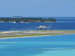 Landing Runway 18 (╚ DD╔) Tags: blue sea sky sun male green water beautiful clouds islands airport aircraft resort airbus maldives didi runway a320
