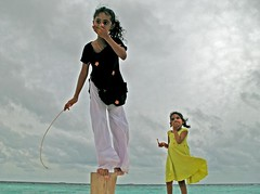 shy girls (ahmed (John)) Tags: travel girls sky cloud playing love beach kids john photo flickr hand culture shy lagoon maldives affair globalvillage excellence yougotit toursim plus4 golddragon itsabeautiful globalcity plus4excellence megashot invitedphotosonly gvadminshalloffame invitedphotosonlyplus4 ineterest