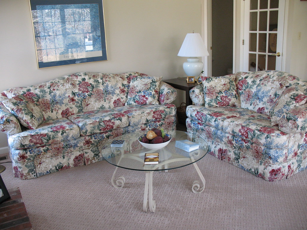 Sofa and Love seat  $400 each; Coffee table with wrought iron base and galss top $50.