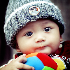 My Ball... (wazari) Tags: boy portrait baby art smile face kids pose children bigeyes lomo eyes nikon asia child emotion expression posing son myson malaysia emotional anakku melayu malay wajah anak potret 50mmlens nikond200 availablelightphotography naturallightphotography anakkecil haiqal wazari expressi aseankids