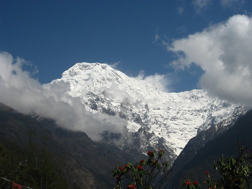 Annapurna South with Hiun Chuli masked by clouds to the right