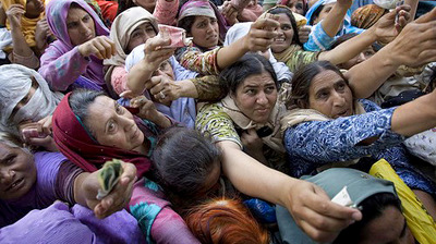 Pakistani women rush to place their orders outside of a subsidized food store on the outskirts of Islamabad.