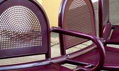 sit #09 (Harry Halibut) Tags: street bench maroon circles seat sheffield images holes exchange allrightsreserved urbanarea colourbysoftwarelaziness imagesofsheffield 2010andrewpettigrew circlescirlcescircles sheff100404125