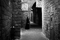 Muslim woman in the streets of Tripoli   - LEBANON - (C.Stramba-Badiali) Tags: street people blackandwhite lebanon woman black contrast person noiretblanc femme muslim islam religion hijab culture souk leader tradition tripoli politique lebanese politic liban 135mm islamicculture culturemusulmane westernasia 5dmkii   christophestrambabadiali