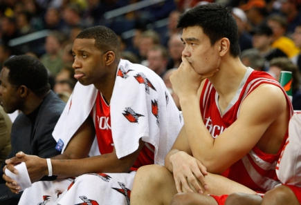 Yao Ming and Tracy McGrady sit depressed near the end of the game as the Rockets got blown out by Golden State, losing 113-94.  Both players scored 21 points collectively.