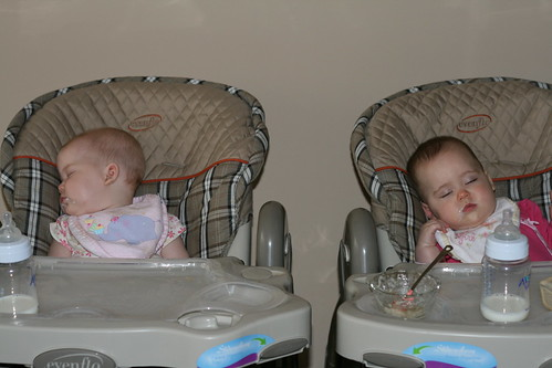 The girls asleep in their high chairs