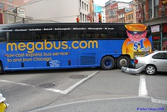 Discount Driver (Sohailsk) Tags: blue bus yellow silver downtown pittsburgh tour accident bumper fender oops doh megabus tourbus