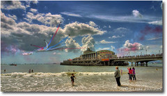 (Claire Hutton) Tags: uk sea summer england sky people beach clouds pier town seaside airplanes airshow event dorset bournemouth hdr redarrows raf aeroplanes tonemapped august2007 aplusphoto