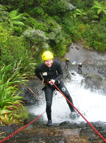 Abseiling a 20-meter waterfall in New Zealand