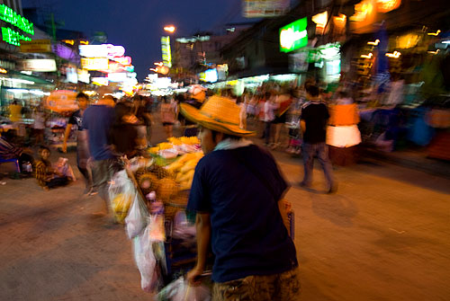 A vendor being chased away from Thanon Khao San