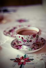 more tea? (JoelDC) Tags: cup coffee floral table 50mm nikon focus pattern dish tea drink bokeh dining tablecloth teacup teatime saucer bonechina d80 diamondclassphotographer