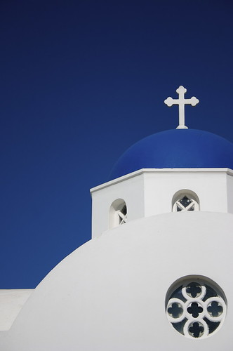 Photo of a Greek Orthodox church with a blue dome.  Santorini, Greece, June 2008.
