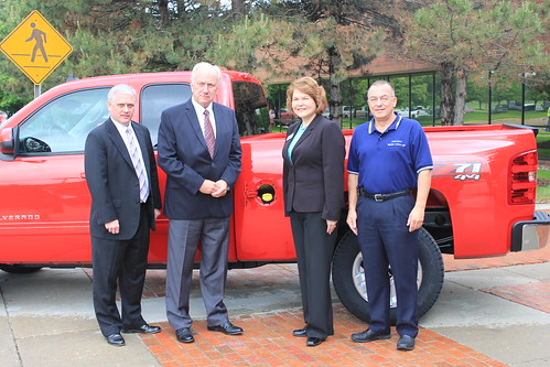 Phil Lehmkuhler, USDA Rural Development Indiana State Director, David Howell, VP Indiana Corn Marketing Council, Judy Canales, and  Nick Kassanos, Assistant Plant Manager of Fort Wayne Assembly, pose in front of a 2011 Flex-Fuel Chevrolet Silverado HD.