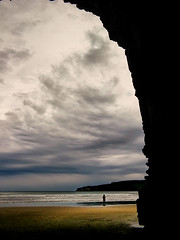 When Building Temples, Nature Thinks Big (Peter Kurdulija) Tags: ocean new storm beach nature beauty yellow clouds canon dark landscape island golden sand scenery solitude 2000 cathedral south gray entrance wave powershot caves zealand human figure makati moment catlins blurb reelection a710 waipati owaka kurdulija