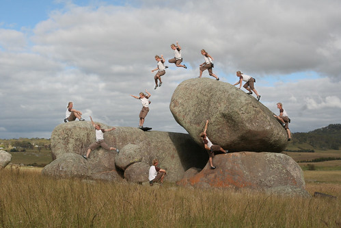 Action sport Parkour freestyle jump walking on a nature rock in a field