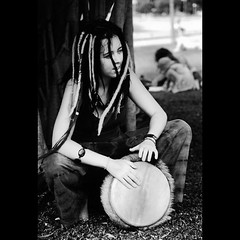 Pricilla, Drum of the Desert (D A M R O W N E Y) Tags: portrait bw music white black film smile dreadlocks contrast drums drum australia highlights sharp depthoffield beat qld queensland drumming dynamicrange cairns dreads loud hapiness synthetics tonality syntheticdreadlocks adamrowney