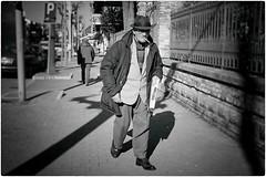 Urban Cowboy (Steve Lundqvist) Tags: homeless poverty street streetphotography fujifilm x100s candid eyecontact shot old man poor walking winter elderly aged age people wise wisdom cigarette smoke smoking hat cappello sunglasses coat jacket newspaper blackandwhite bw italy italia