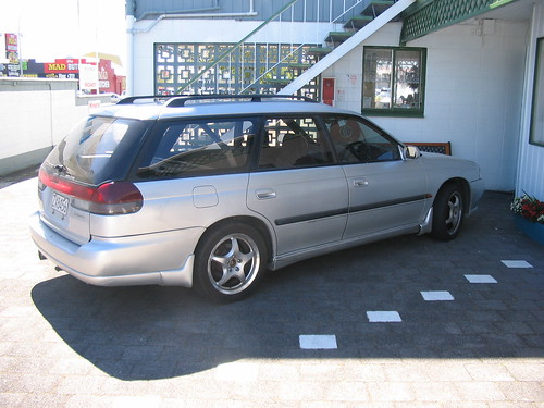 It is a 1995 Subaru Legacy station wagon, automatic, with a sunroof and a
