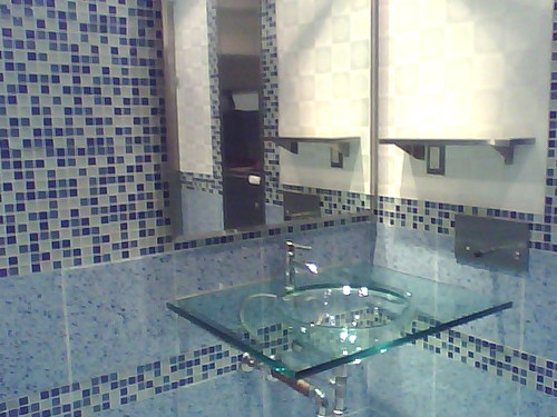 Modern-traditional-design-bathroom-in-blue-gamma-with-glass-sink