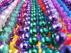 Mardi Gras Beads (jciv) Tags: desktop carnival party wallpaper macro beads louisiana colorful neworleans decoration mardigras celebrate decorate krewe throws file:name=img4169