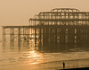 Brighton West Pier reflecting light (david.nikonvscanon) Tags: world camera original winter sunset mist cold west misty digital photoshop photography sussex pier photo search saturated brighton photographer image decay steel postcard creative commons icon images structure photograph luck lucky pixel creativecommons saturation surprise dp digitalphoto find chromatic digitalimage theworld digitalphotograph oneworld aberation nikonvscanon viewtheworld davidnikonvscanon