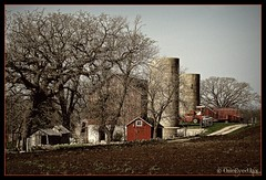 Farm in Springtime (OneEyedJax) Tags: tractor wisconsin rural countryside spring farm country may farmland silo loveit oaktree redbarn smorgasbord plowedfield mywinners anawesomeshot diamondclassphotographer excellentphotographersaward brillianteyejewel betterthangood theperfectphotographer multimegashot