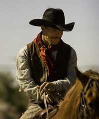 Cowboy (Domain Barnyard) Tags: vegas portrait people man male hat happy cowboy flickr ride searchthebest lasvegas nevada may trails canoneos20d trail riding western rides 2008 f28 horseback trailride wildwildwest cowboyup tingey 155mm domainbarnyard westerntrailsneighborhoodpark 7023872457