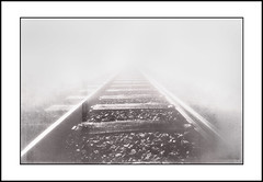Traintracks in the mist (Kenneth McNeil) Tags: misty photoshop geometry traintracks dream wideangle eerie symmetry symmetrical dreamy geometrical ghostly 2009 backhome 1224 vestjylland blackwhitephotos kennethmcneil