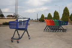 Shopping trolleys in several colours.