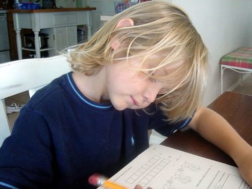 k schoolwork, hair in his face