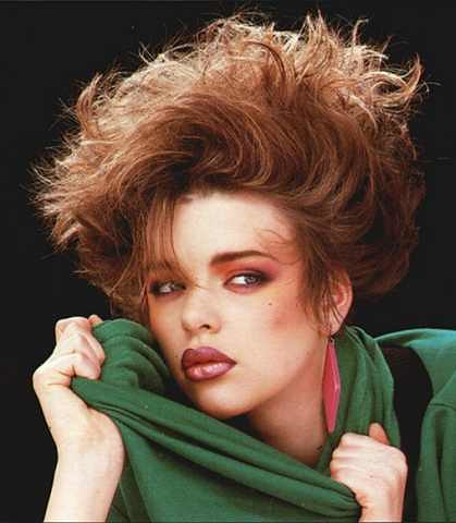 I'm supposed to go to an 80's party on Friday. Here's some hair and makeup photos I found that I might try.