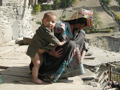 Kalash lady & Baby (imranthetrekker , new year new adventures) Tags: pakistan snow afghanistan mountains history tourism church nature architecture river oak adventure glaciers greenery peshawar suspensionbridge polo nwfp juniper mosques shepherds silkroute chitral khyberpass colorsofautumn hindukush terichmir romboor torkham imranthetrekker imranschah northpakistan kalashvalleys shandoorpass muhabbatkhanmosque nooristan bamborate chitralguy thecastleoffairies trekkinginkalashvalleys shandoorfestival stctahedral kalashpasses donsonpass kundayakpass kalashgilrs