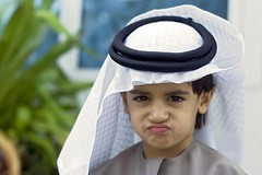 he just loves Eid =P ... (Anas Bukhash (nascity)) Tags: boy baby cute kid funny child expression traditional eid traditions arabic arab ghitra kalkool nascity