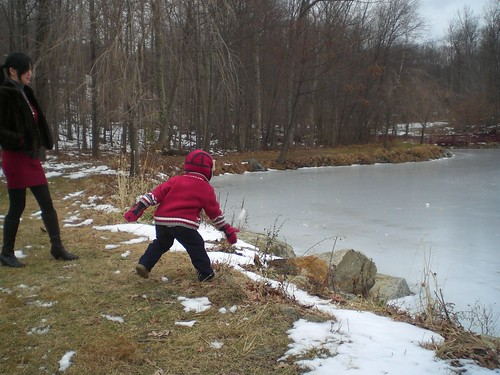 Julian thrawing snow ball at the icy lake