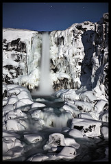 Ice (LalliSig) Tags: blue winter cliff white snow motion black cold ice water rock night landscape waterfall iceland rocks nightscape