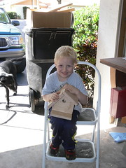 Zachary shows off his birdhouse
