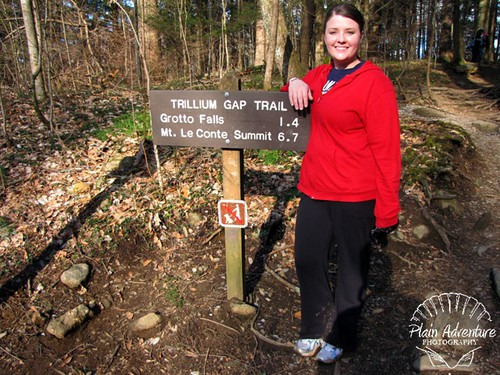 Karen with Grotto Falls Sign watermark