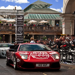 Lamborghini Murcielago LP640 'Rosso Vik' (Thomas van Rooij) Tags: charity city uk red london cars wet car rain weather start garden photography italian nikon thomas united rally continental kingdom automotive run nixon vik event exotic covent puma nikkor rosso 3000 lamborghini supercar bentley bats gumball exotics supercars londen murcielago v12 18105 supersports gumball3000 evenement 2011 d90 lp640 muvi rooij veho betsafe thomasvanrooij