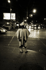 sneaky hombre (tanjatiziana) Tags: bw toronto man hat night noir headlights intersection collegest crosswalk bathurst poncho hombre circ2008