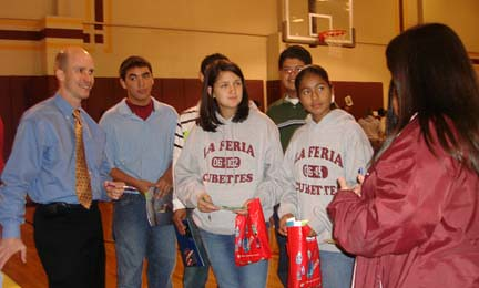Keith Cogdill and Monica Tovar with eighth graders in La Feria