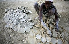 Ever had Haitian cookies? (gurjeet kaur) Tags: world poverty charity food woman haiti mud humanity poor compassion carribean seva dirt aid health filth brotherhood developingcountry destitute malnourished thirdworld malnutrition penniless gareeb gursikhduty sarbatdabhala