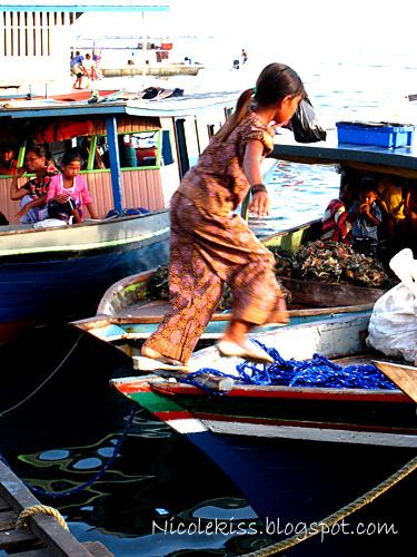 girl hopping on boat