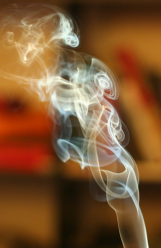 Photo of attractively curling cigarette smoke